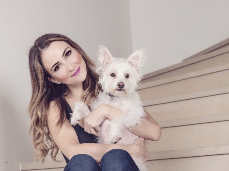 Shira Astrof of the Animal Rescue Mission with Terrier Dog