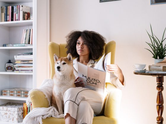 woman sitting in chair with dog
