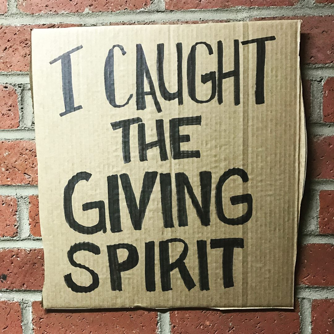I caught the giving spirit cardboard sign