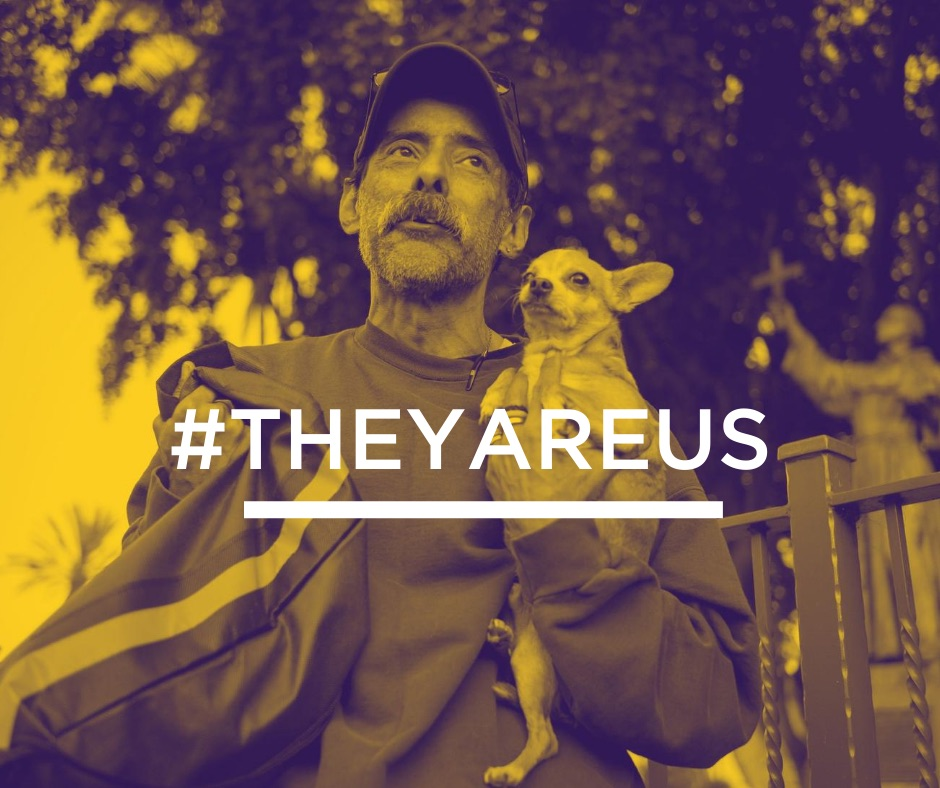 Text #TheyAreUs and man with chihuahua
