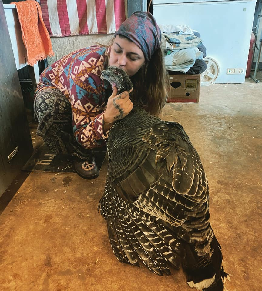 woman kissing a turkey