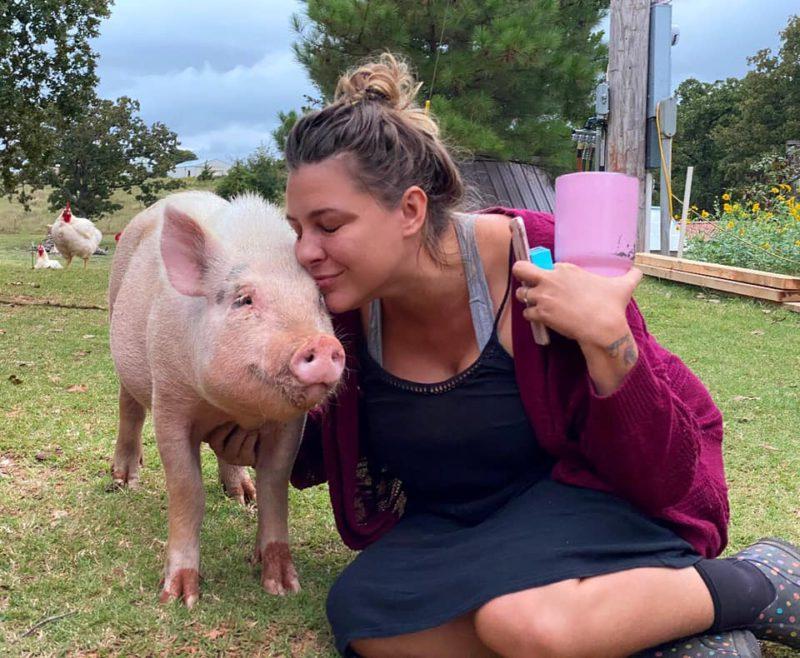 jennie hugging a pig