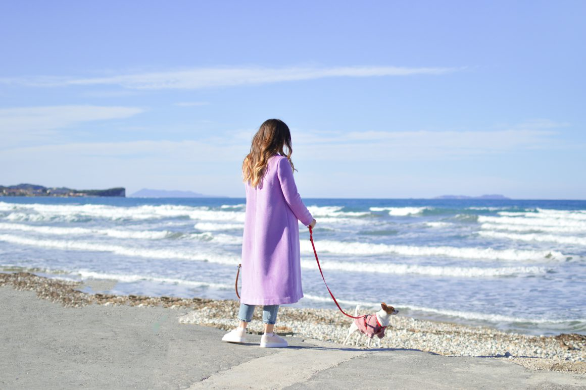 woman on beach with dog