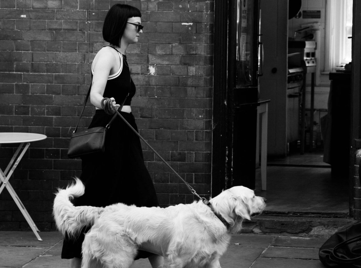 black and white woman and dog