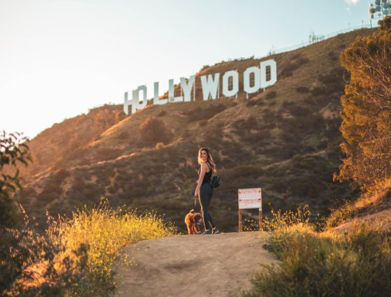 woman with dog and hollywood sign
