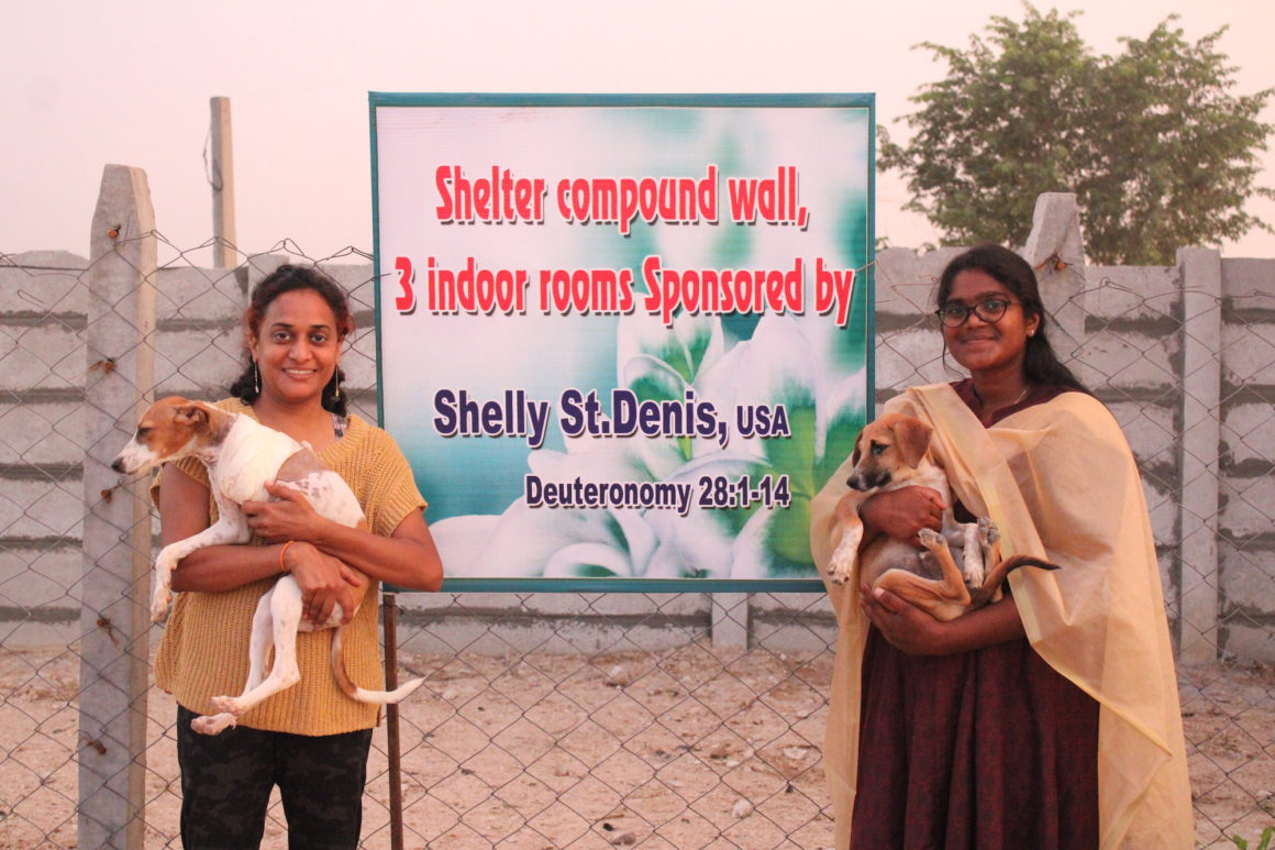 stray animal foundation women with sign